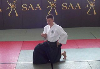 Aikido Standing Up to Kamae, Half-Standing Position